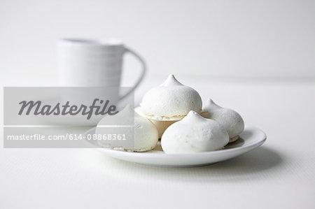 Mini meringues on plate