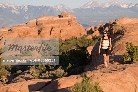Hiker exploring rock formations