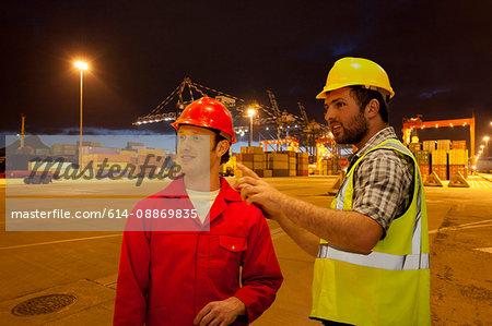 Workers talking in shipyard