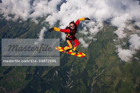 Man skysurfing over Reichenbach, Bern, Switzerland