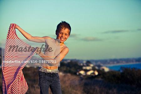 Boy holding striped fabric