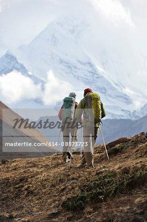 Trekker hiking a ridge in Thorung La, Nepal