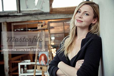 Mid adult woman in artist's studio, portrait