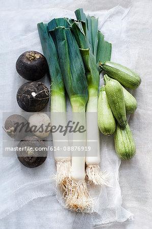 Still life of leeks with black turnips