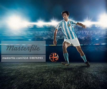 Footballer chasing ball