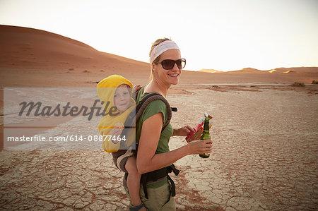 Mother and son on sand dune, Namib Naukluft National Park, Namib Desert, Sossusvlei, Dead Vlei, Africa