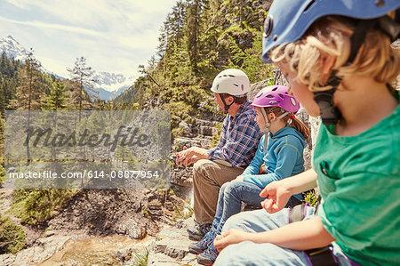 Father and children enjoying view on hill, Ehrwald, Tyrol, Austria