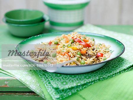 Vegetable rice in green vintage bowl