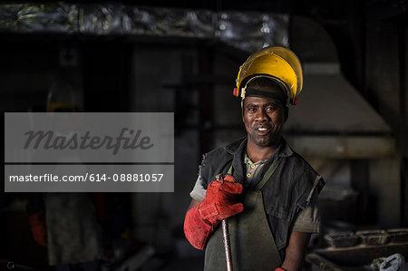Portrait of metalworker in foundry
