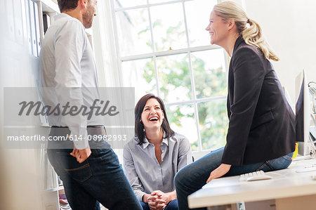 Design team having discussion in creative studio meeting