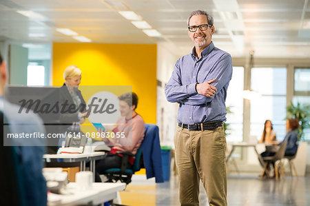 Portrait of mature male digital designer in office