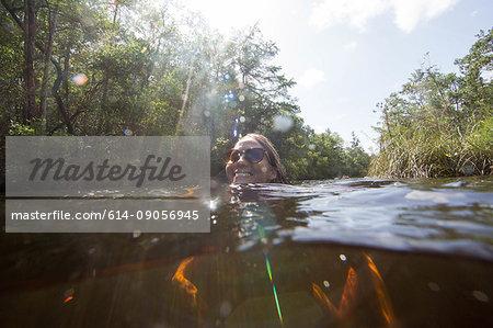 Woman swimming in water, Destin, Florida