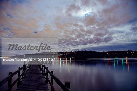 Lights across water on coastline from pier, Bainbridge, Washington, United States