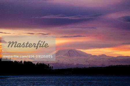 Snow covered mountain at sunset, Bainbridge, Washington, United States