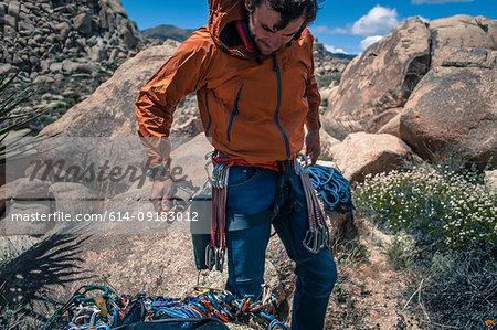 Rock climber wearing safety gear, Joshua Tree, California, USA