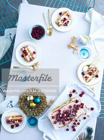 Tray of raspberry macadamia vacherin layer cake on christmas table