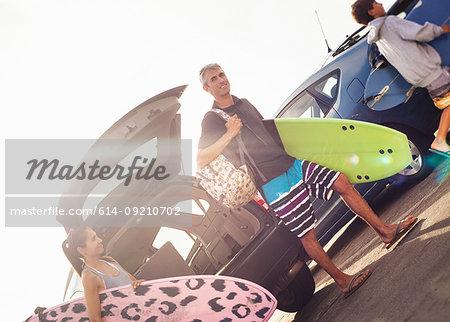 Family carrying surfboards, Encinitas, California, USA
