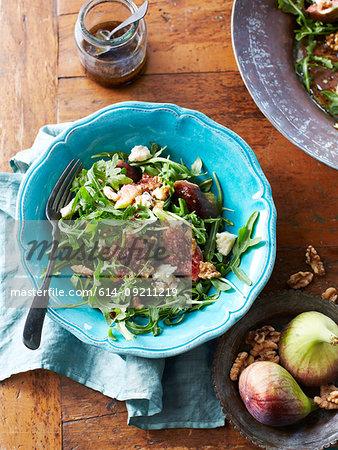 Still life of salad with walnuts, figs and gorgonzola