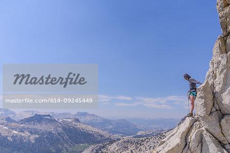Climber trad climbing, Tuolumne Meadows, Yosemite National Park, California, United States