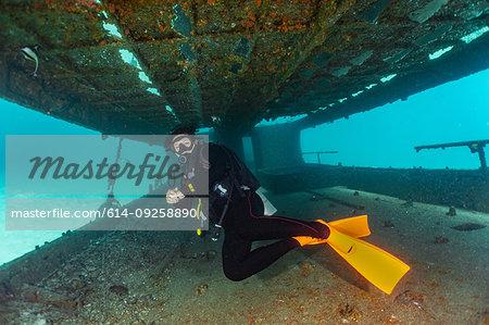 Diver exploring ship wreck, Ko Racha Yai, Rawai, Phuket, Thailand