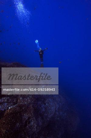 Man free diving, Revillagigedo Islands, Socorro, Baja California, Mexico