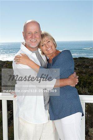 Senior Couple Embracing on a Balcony
