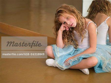 young ballerina sitting in studio