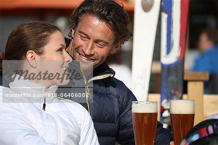 Couple enjoying drink at ski resort