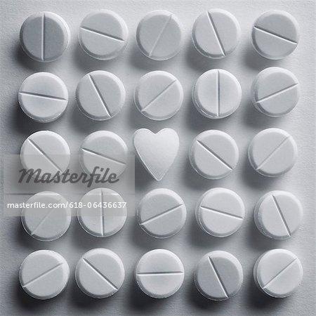 heart shaped pill amongst standard pills