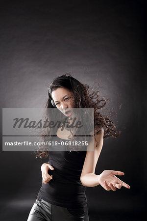 Woman Rocker Doing Air Guitar