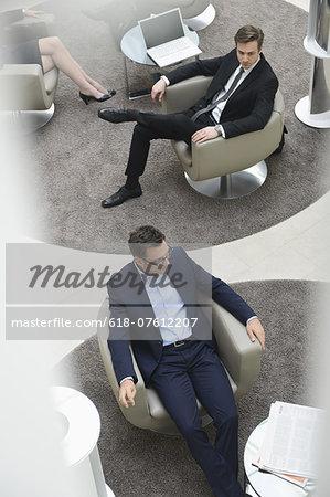 Businessmen sitting in lobby