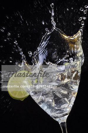 Ice cubes splashing into a drink