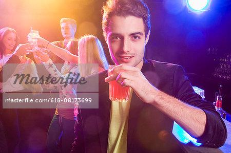 Portrait of friends celebrating in nightclub