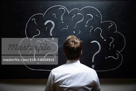 Businessman in front of Blackboard