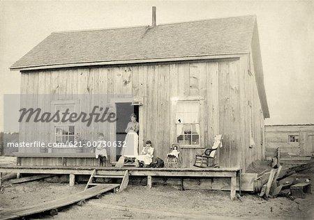 Family Outside of Cabin