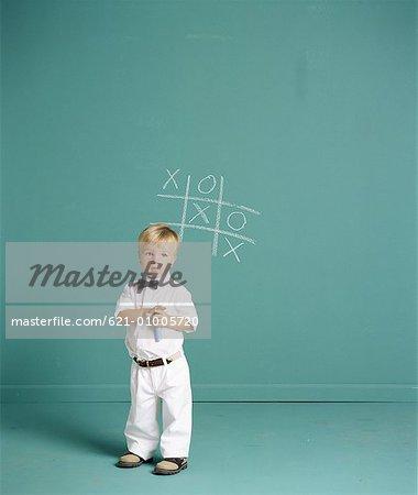 Little Boy Playing Tic Tac Toe