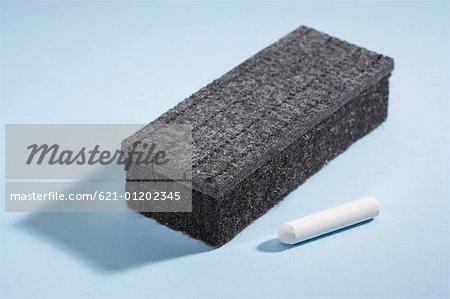 chalkboard eraser and chalk stock photo masterfile premium