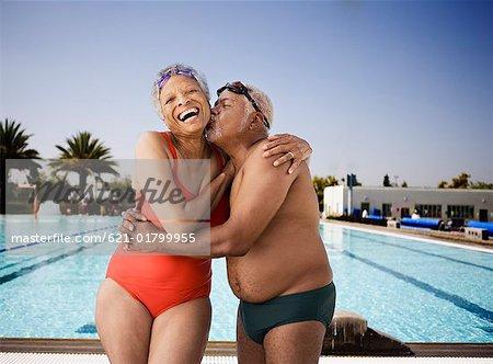 Senior swimmer couple embracing