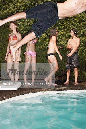 Teenagers at swimming pool