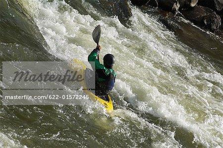 Kayaker Negotiating the River