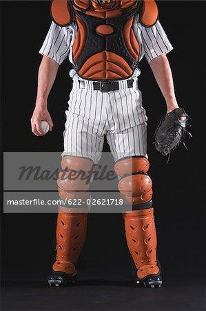 Baseball catcher with black background