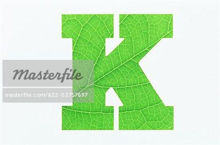 Green Alphabet K on White Background