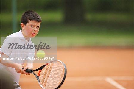 Caucasian Boy Hitting Ball