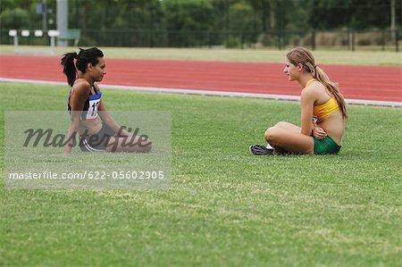 Two girls Runner Resting In Lawn