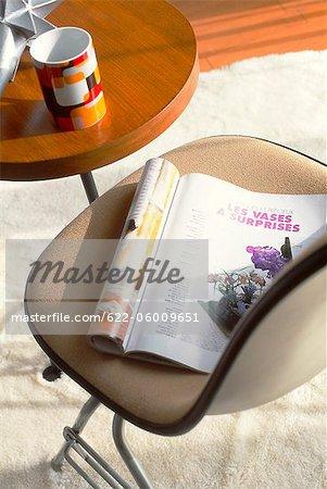 Magazine On Chair And Mug On Table
