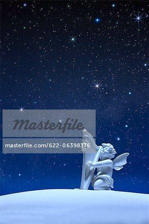 Angel statue and stars