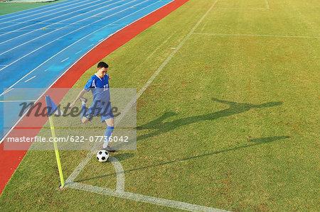 Football player taking a corner kick