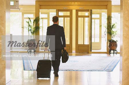 Businessman leaving hotel