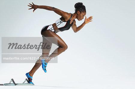 Female Athlete Leaving Starting Block