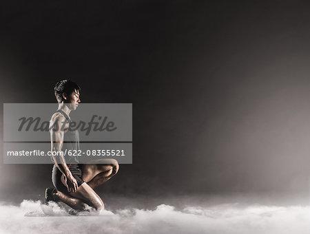 Japanese male athlete preparing to run